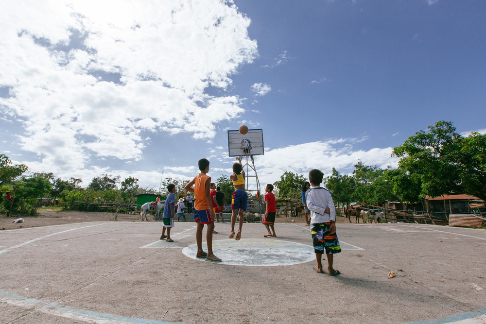 Surprisingly there's a whole village on Taal Island where people live. Kids play basketball on Taal Island, Philippines.