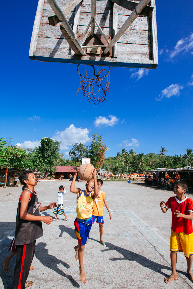 Kids play basketball on Taal Island, Philippines.