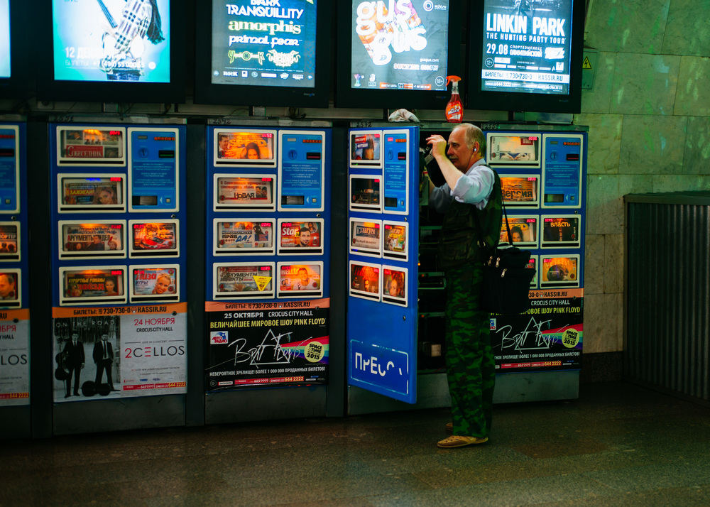 Repairing newspaper vending machines in Moscow subway.