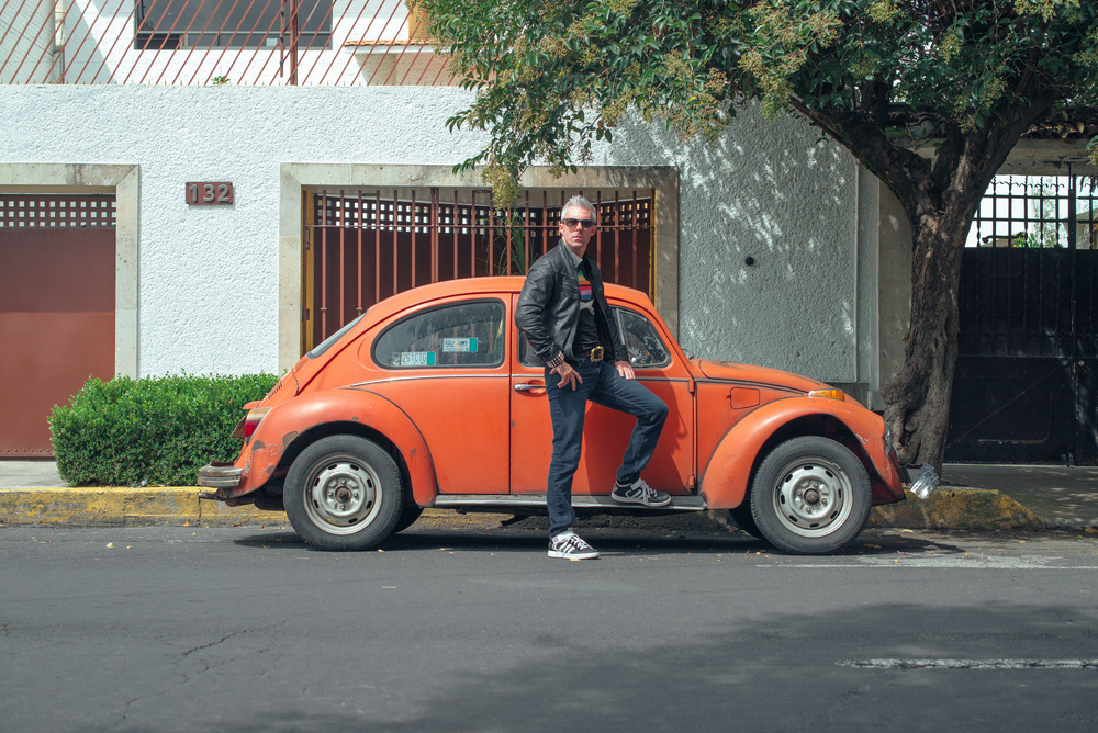 James White aka Signalnoise posing next to old VW Beetle. Surprisingly an entire Mexico is full of Beetles. They are literally on every single corner around an entire country.