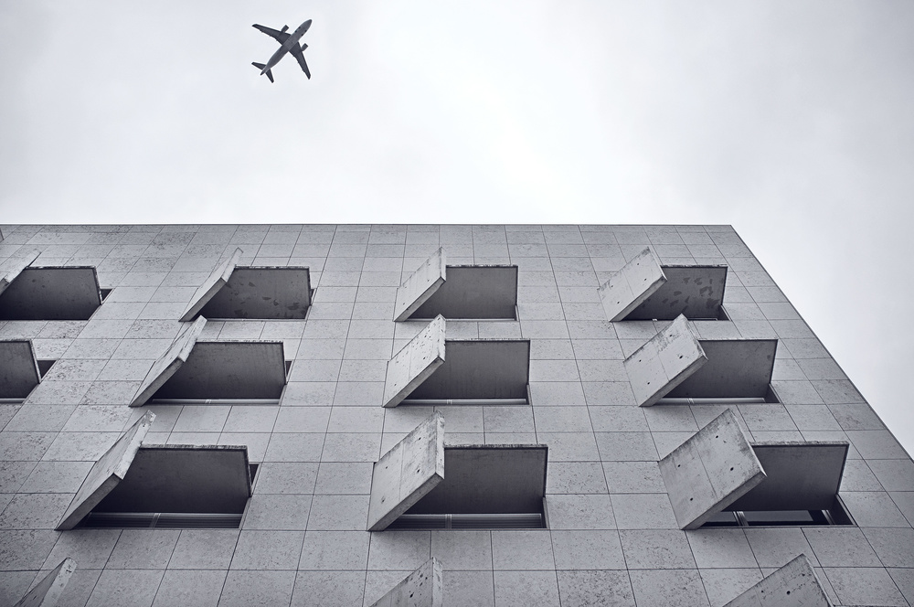 Plane approaching Lisbon Airport, Portugal. The photo was taken on the streets of Lisbon.