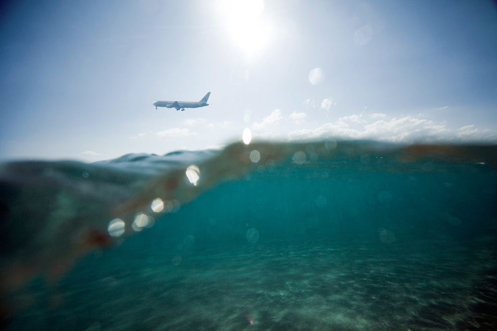 American Airlines Boeing 767 approaching Kahului Airport, Maui Island, Hawaii. The photo was taken with underwater case while being in the ocean on the North Shore of Maui Island.