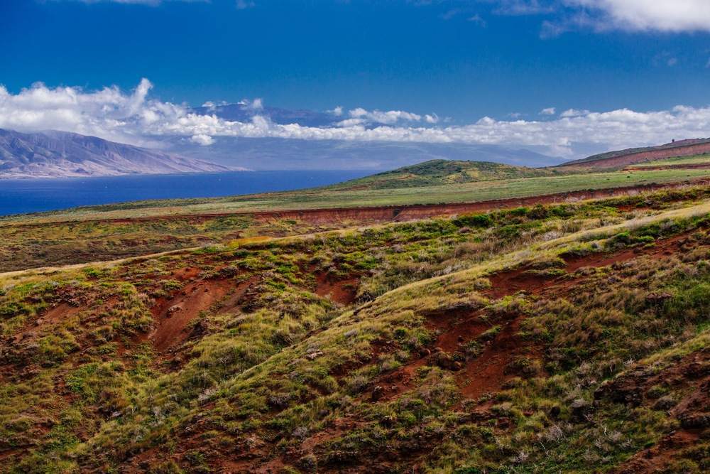 View of Lanai and Maui island on the background. Western part on the left and East Maui with Haleakala Summit on the right.