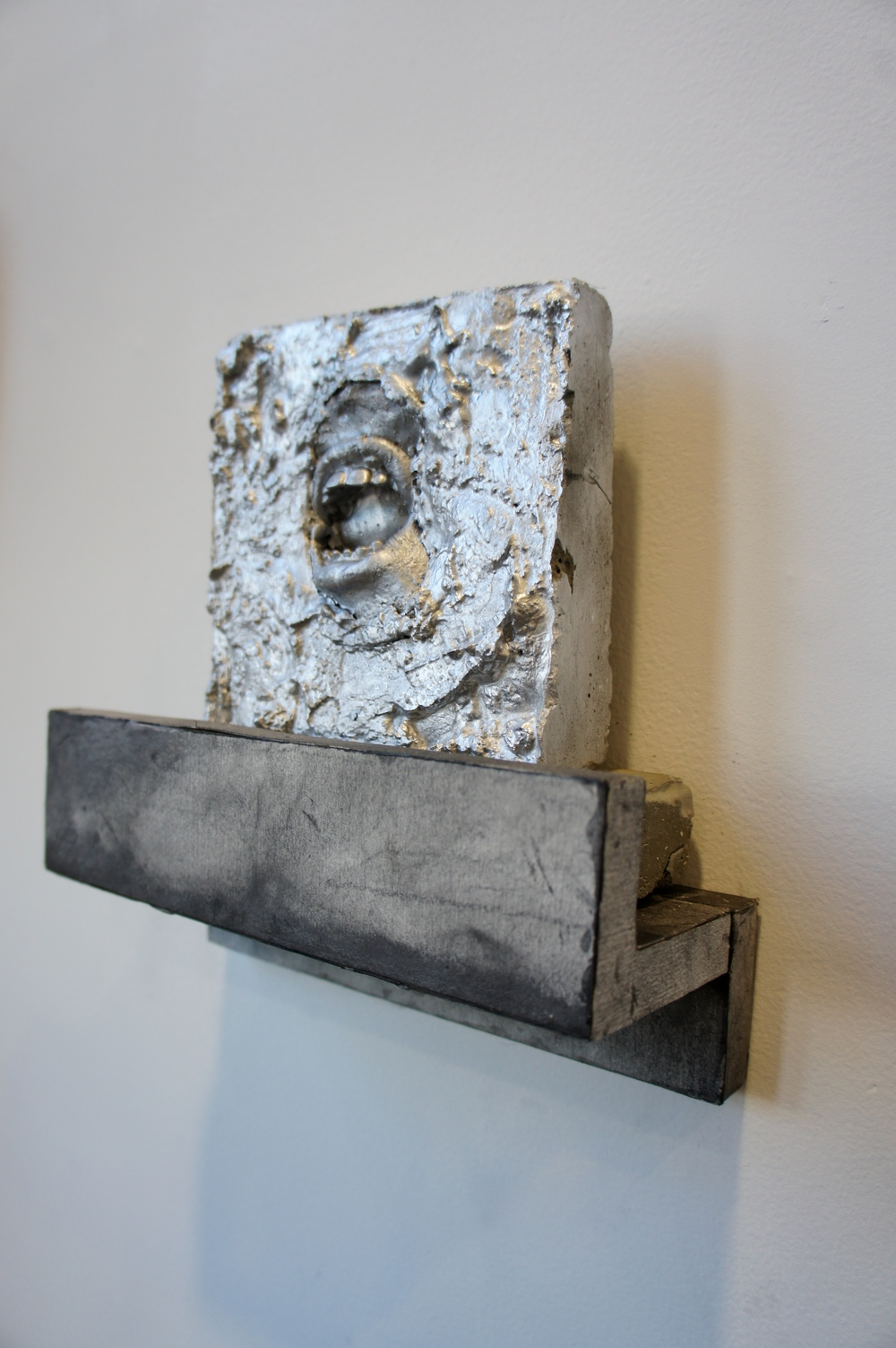 Kill Your Idols , 2015. Cement, silicone, wood, graphite on paper. Approximately 8 x 8 x 3 in.