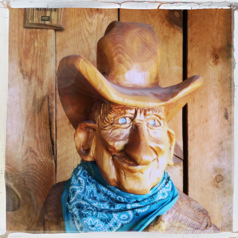 This creepy wood carved cowboy greets you at the Grand Canyon Caverns.