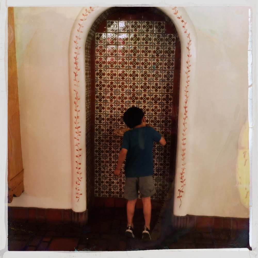 My son quenching his thirst at the La Fonda Inn drinking fountain.