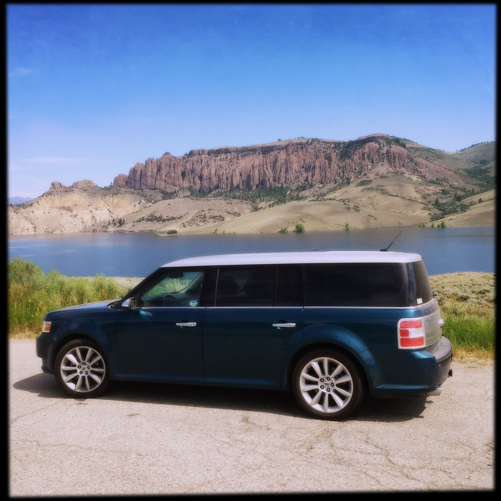 Our trusty Ford Flex in front of the Blue Mesa reservoir.