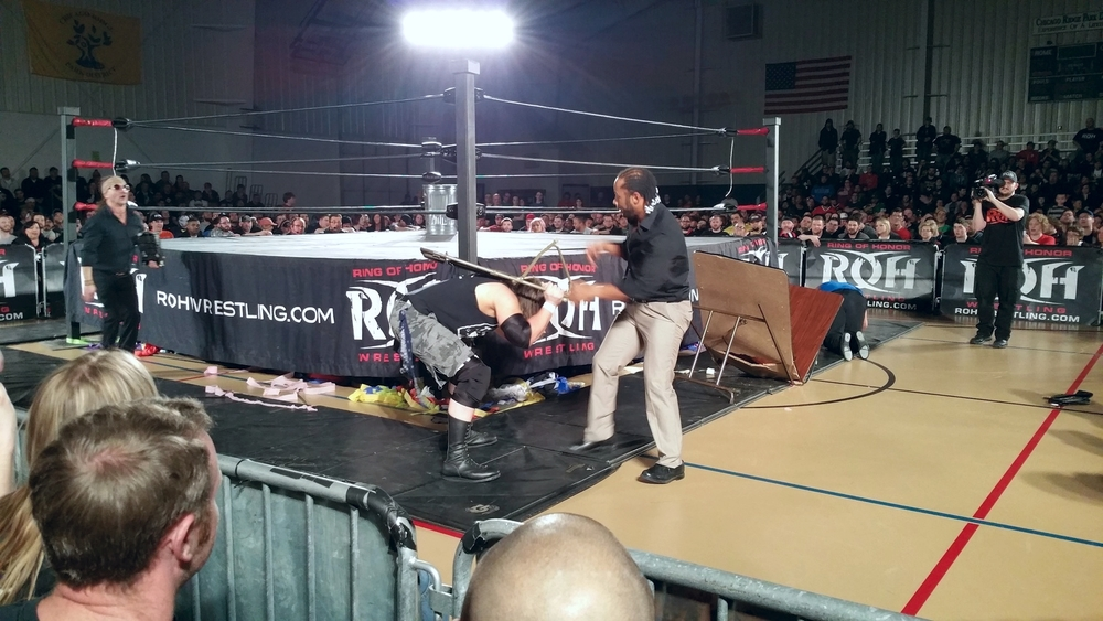 Jay Lethal attacks Cliff Compton with a chair