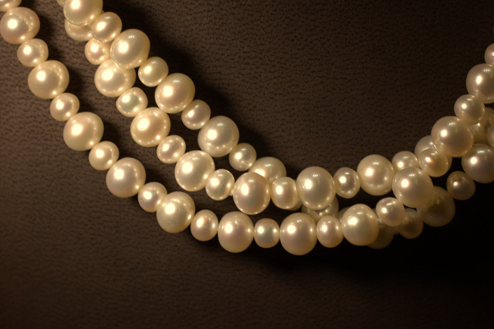 3 row alternating sizes pearl necklace with sterling silver clasp great luster beatiful classic look for a great price lots of bang for your buck available at Marlen Jewelers in Rocky River minutes from Cleveland.jpg