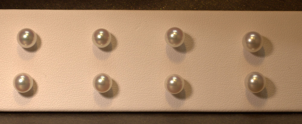 Pearl studs are a classic gift. Every woman needs this staple in her jewelry box. Great gift and they come in all sizes. Perfect to dress up for that formal event or dress down for a everyday wear. Great luster in these white pearl.  $75-$500