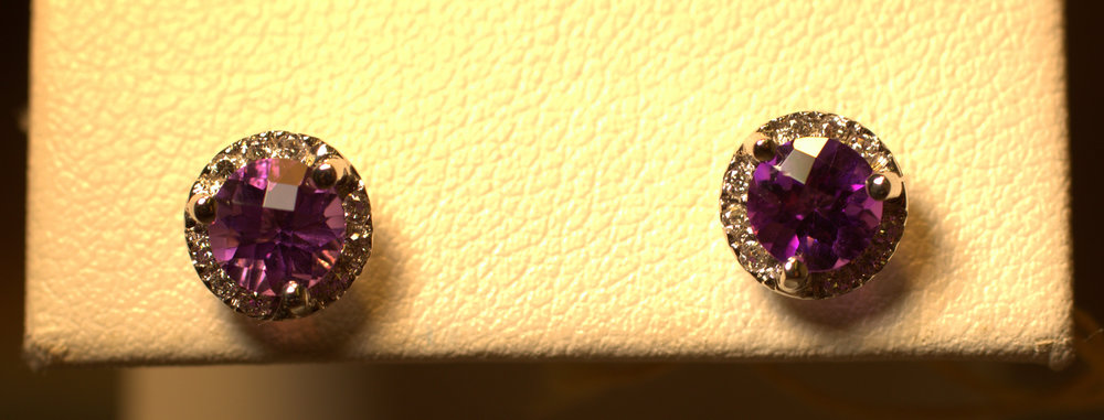Amethyst studs with diamond halo checkerboard cut. Rich, purple amethyst stone with bright white diamond halo. Classic with a modern twist – very chic.  $575