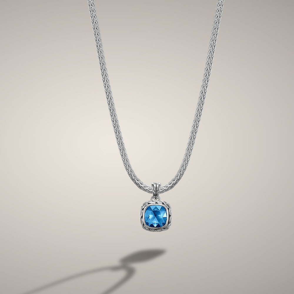 Blue topaz classic chain pendant by world renown designer John Hardy. Available in many colors with classic styling.  $550