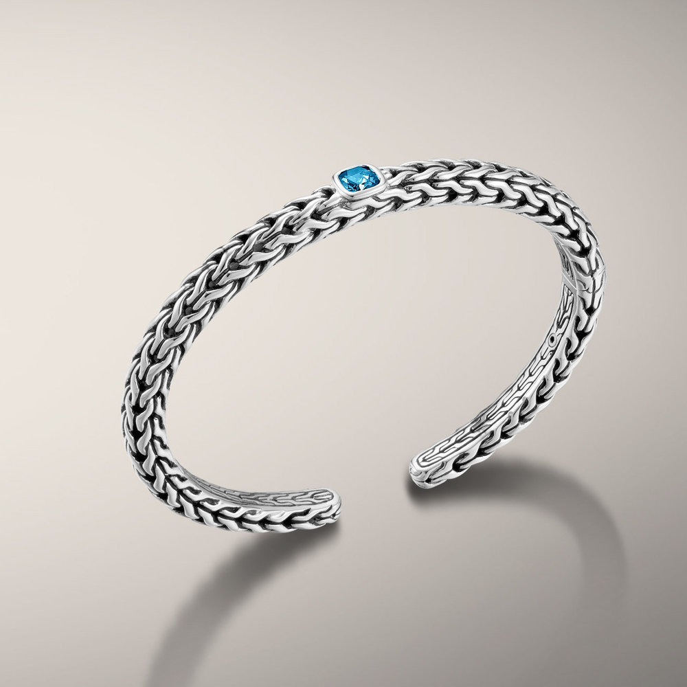 Classic chain and london blue topaz kick open cuff bracelet. Available in many colors. Classic John Hardy woven silver bracelet. All handmade in Bali. Classic look with a pop of color.  $550