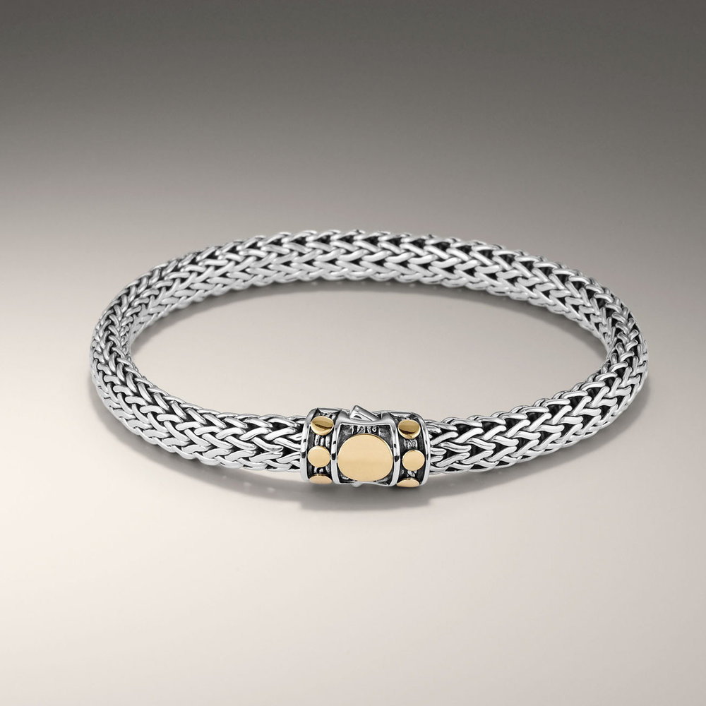 John Hardy dot collection two tone bracelet, with a touch of gold on a classic style woven silver. $475