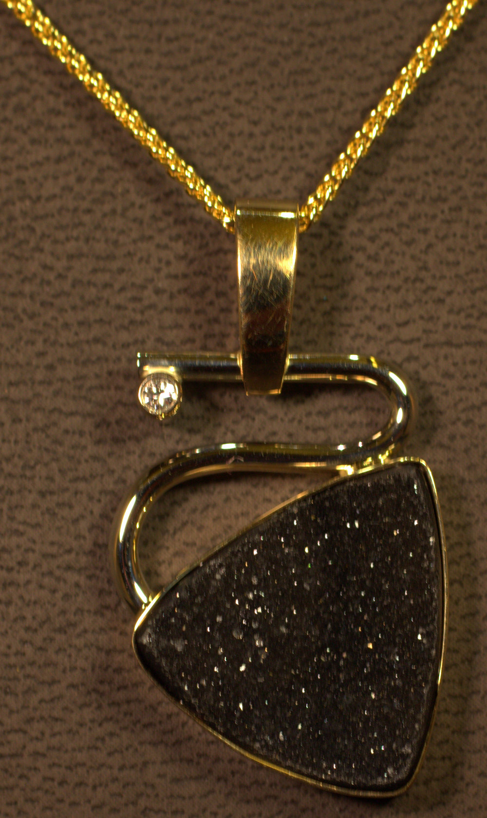Modern styling contemporary drusy quartz and diamond pendant. 14 karat two tone gold on 14 karat yellow gold chain.  $1675