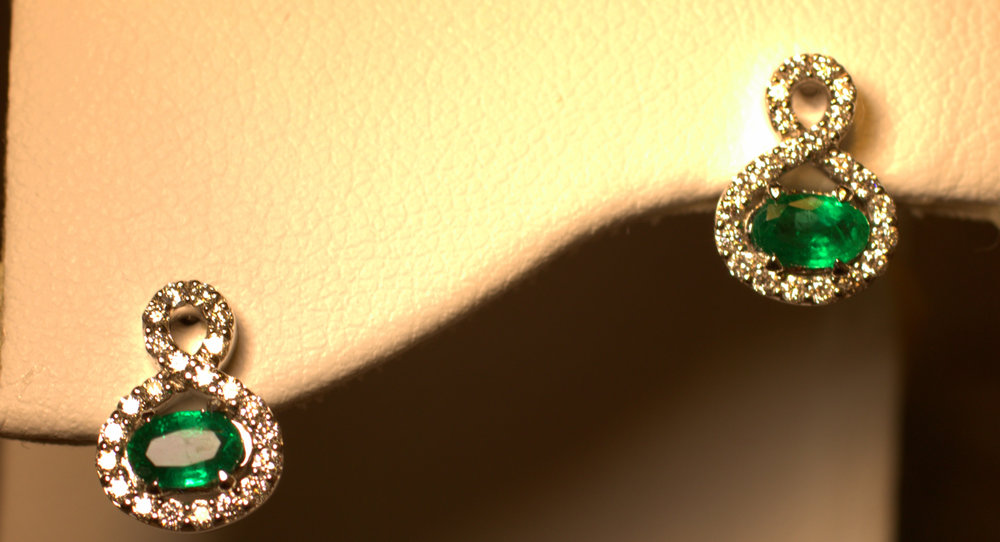 Oval shaped emerald and diamond drop earrings.      $2250