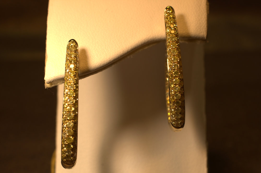 Pave set fancy yellow diamond, canary hoop earrings. Yellow gold and inside out diamonds on both sides.   $7000