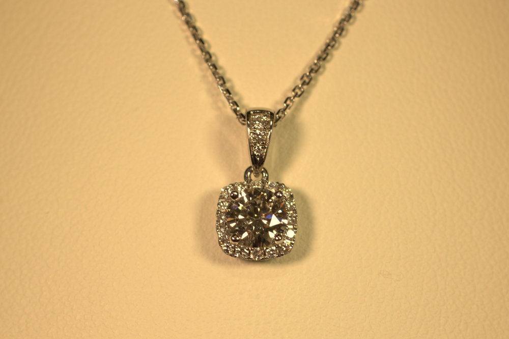 Round diamond with a cushion halo necklace. Brilliant sparkle with a classic diamond bail to add pop.   $3000