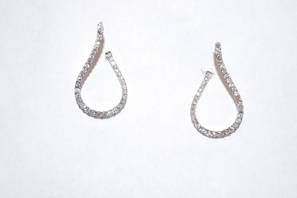 Twisted inside out diamond hoops. The diamonds sparkle from every angle. White gold with well cut diamonds just add pop. A great add on to any diamond ensemble.  $5650