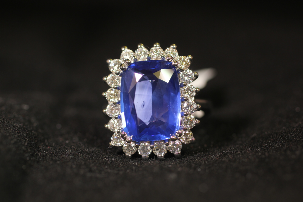 Vintage styling diamond halo cornflower blue sapphire ring. 18 karat white gold. $35,000