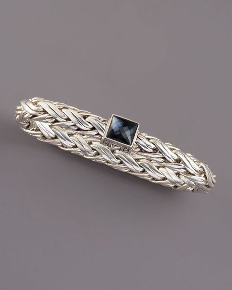 Sterling silver woven together in a rope to make a flexible smooth bracelet. The invisible clasp has a double release on either side and features a 8mm domed faceted hematite on top.  The bracelet is handmade in Bali.