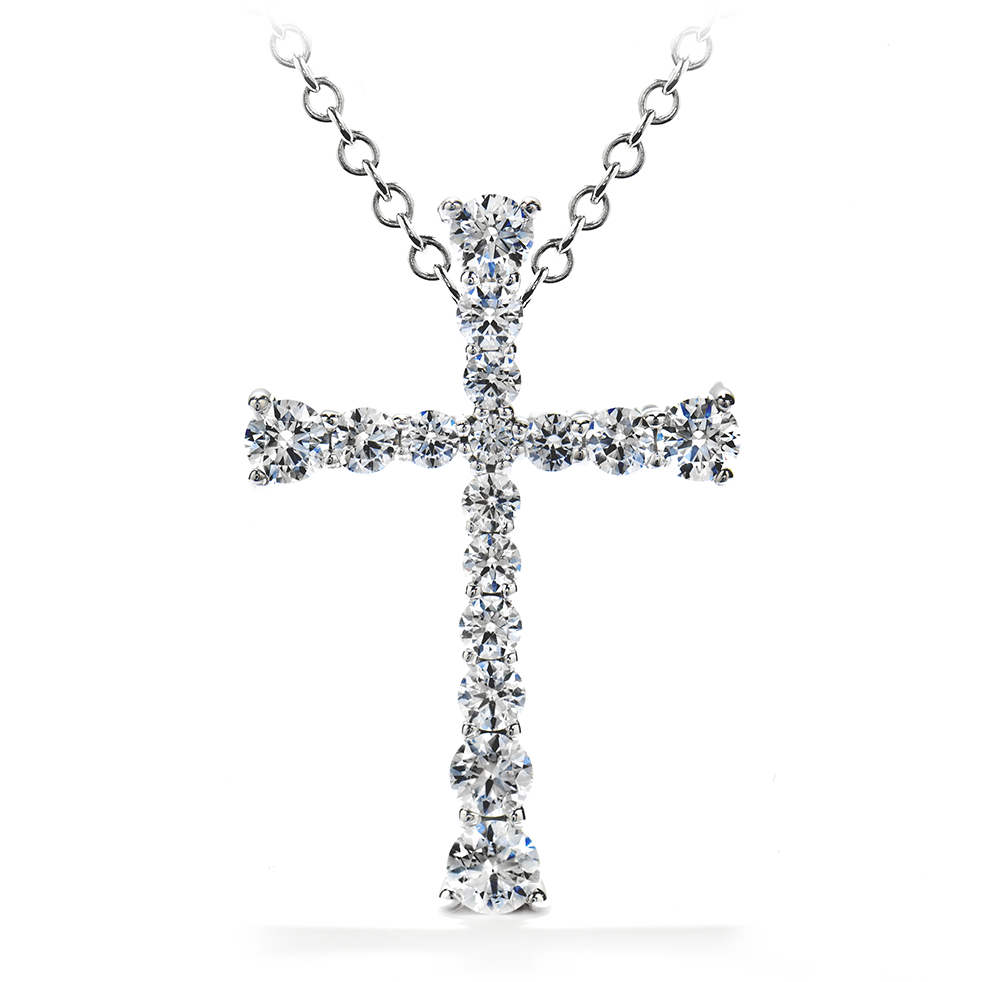 Heart on Fire Divine Journey diamond cross fashioned in 18 karat white gold. The cross features 11 round diamonds graduating in size forming a cross. The 11 diamonds total .25 carats. The Diamonds display G color and VS clarity.