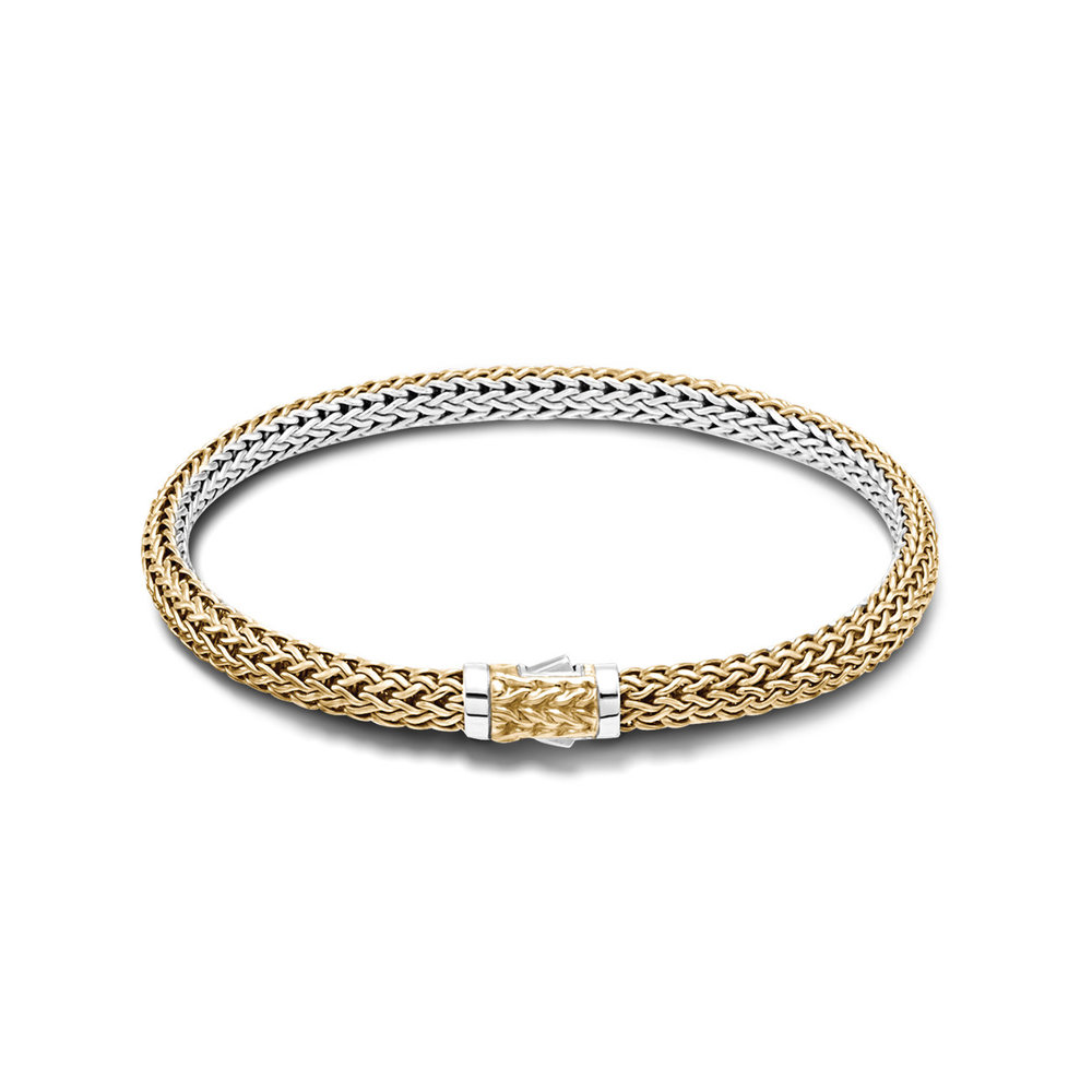 John Hardy 18 karat yellow gold and sterling silver reversible bracelet starting at $1800.00. Hand woven in Bali.