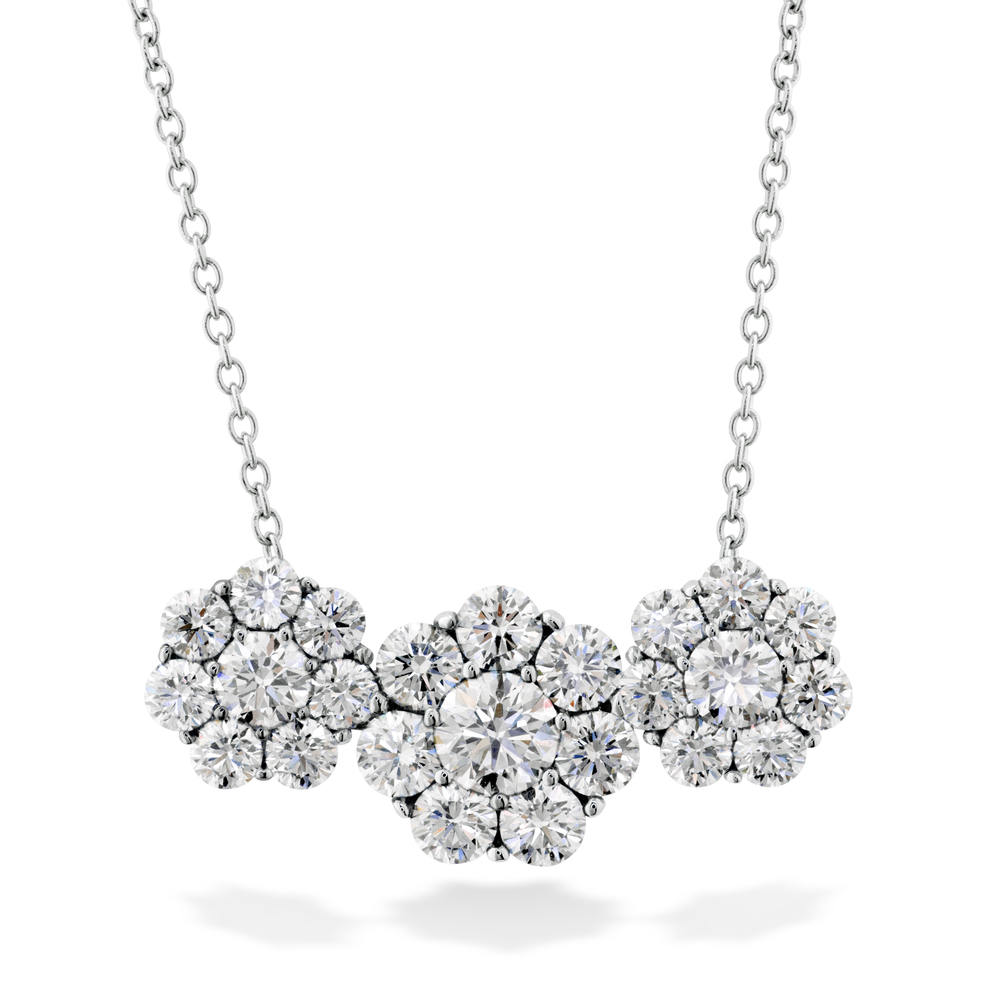 The Hearts On Fire diamond encircled by a lovely halo creates a spectacular display of light in this beautiful diamond pendant necklace times three. This stunning necklace truly makes a statement. The Beloved 3-station necklace can be worn with a casual outfit to add some glam or can be worn with a dressy look to add the finishing touches. The 21 diamonds come out to 2.40 carats of sparkle. The Hearts On Fire diamonds are the world's most perfectly cut diamond and get to show off in this 3 station pendant. This beautiful pendant is valued at $12,750.