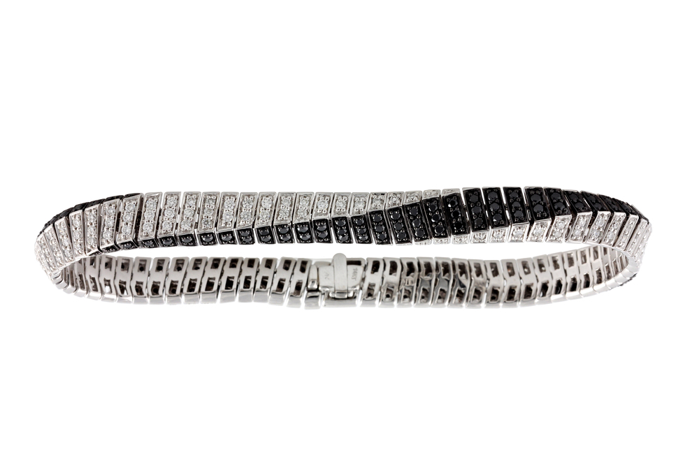 Valued at $9500, this Ladies' bracelet has a total of 3.07 carats of black and white diamonds