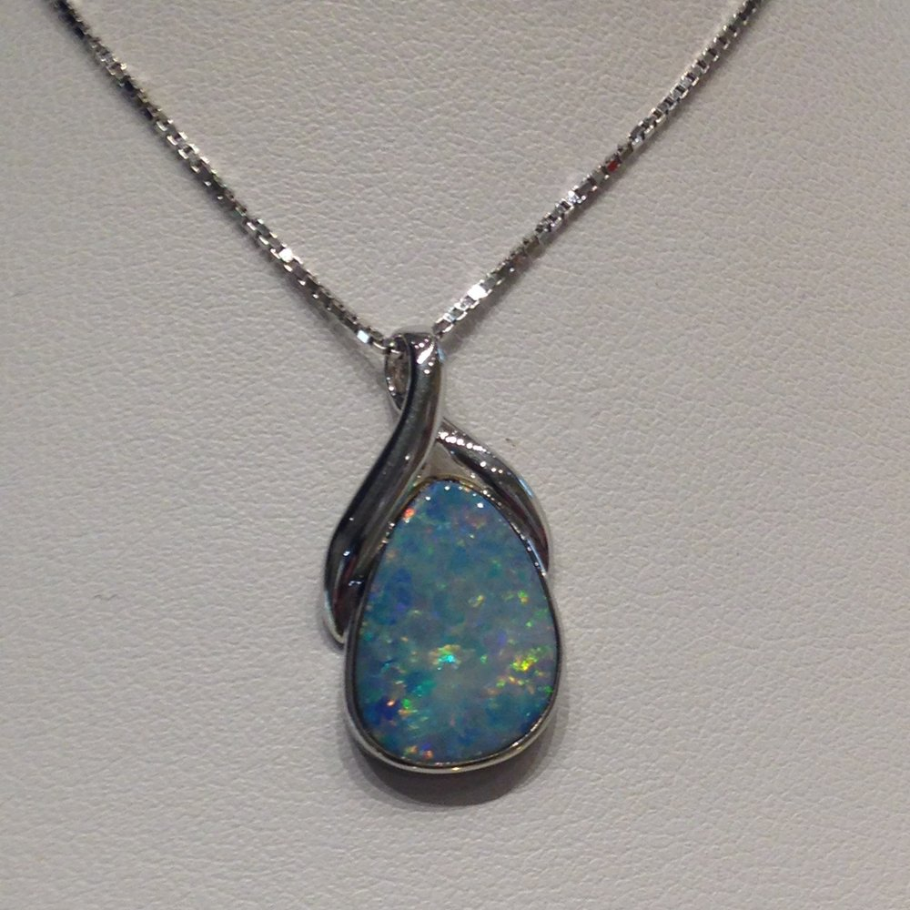 Opals range in color from milky white to black with flashes of yellow, orange, green, red, and blue.