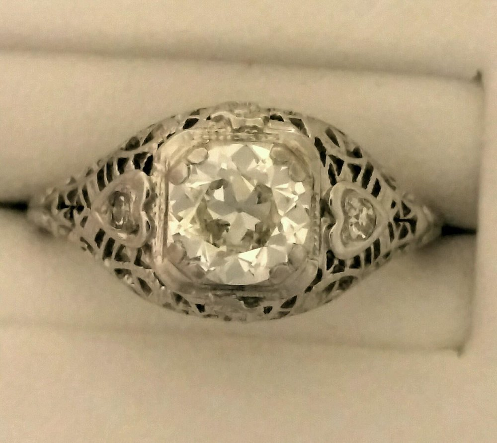 diamond engagement ring fashioned in 18 karat white gold.jpg