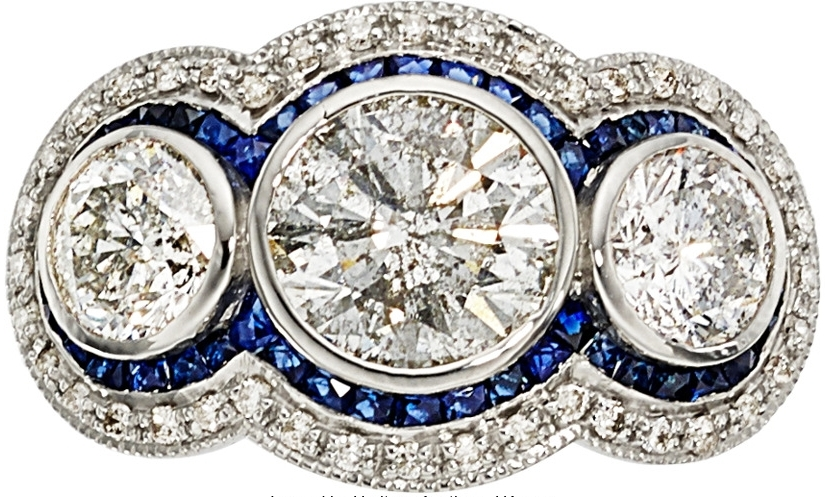 18kw diamond sapphire 3 stone ring - 3.4 total carats of diamonds; includes a 1.86 carat center, 1.23ct side 2 diamonds, French calibre cut sapphire accents