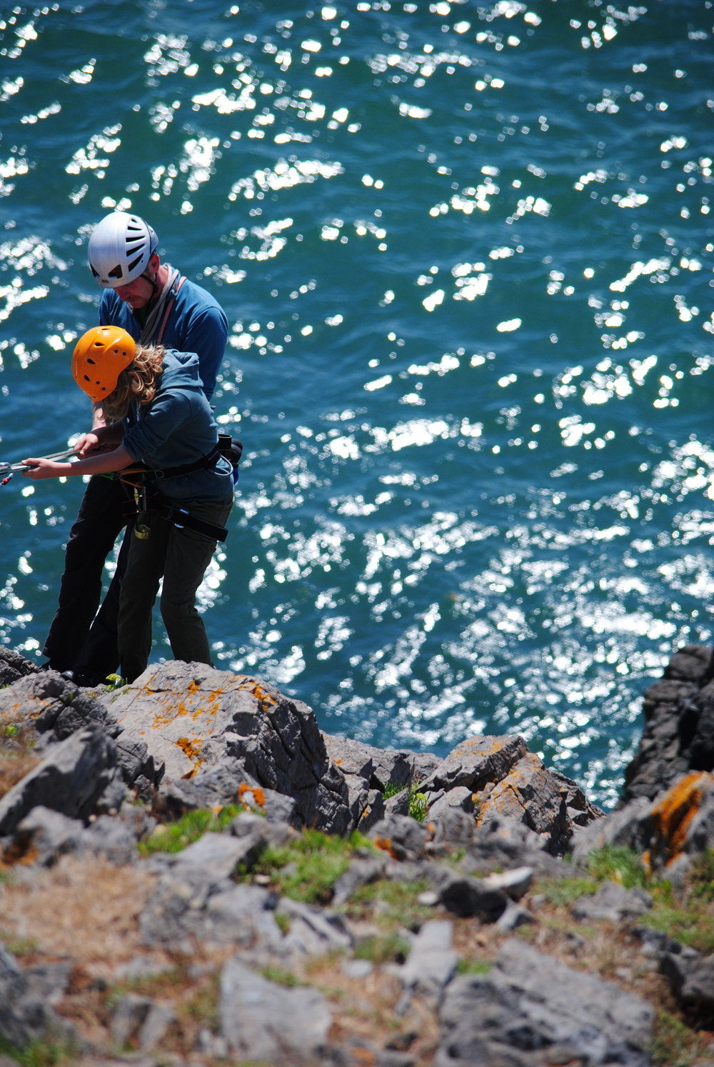 Abseiling into sea cliffs