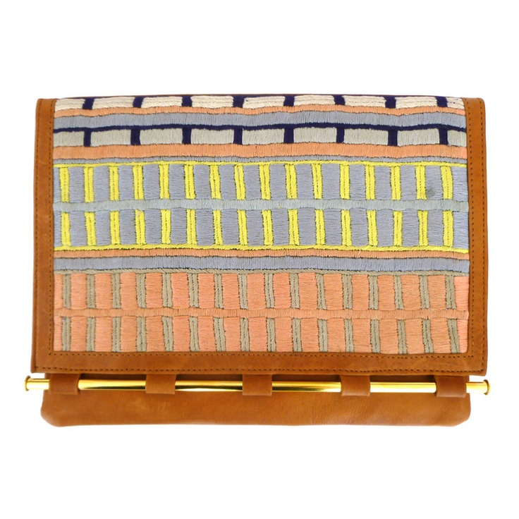 Beautifully embroidered leather clutch via tenoversix.com.