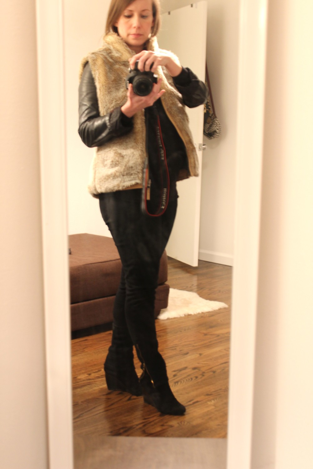 Banana Republic leather jacket, thrifted Gap faux fur vest, Old Navy maternity tee, Paige jeans, Franco Sarto boots