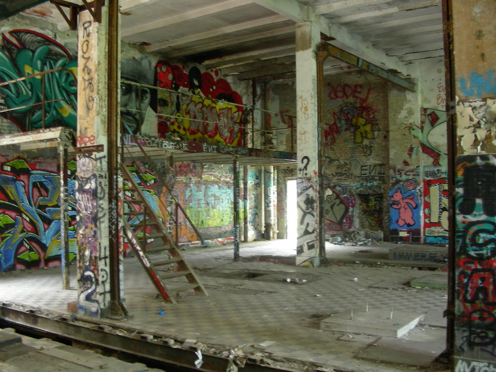 Interior of the factory. The hole in the floor in the foreground appeared to be some sort of storage container.
