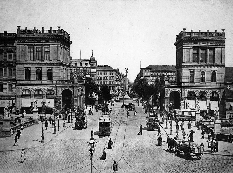 Hallesches Tor in 1894. The gate has been replaced by an open street entryway.  Source .