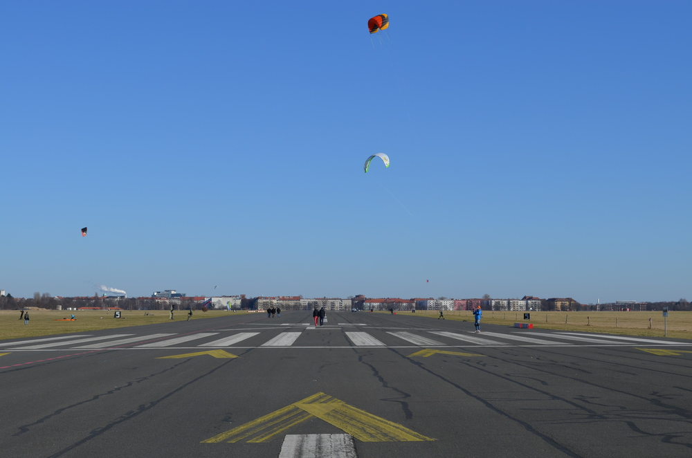 Walking along one of the runways. Kite surfing on skateboards is one of the more popular activities at the airport.