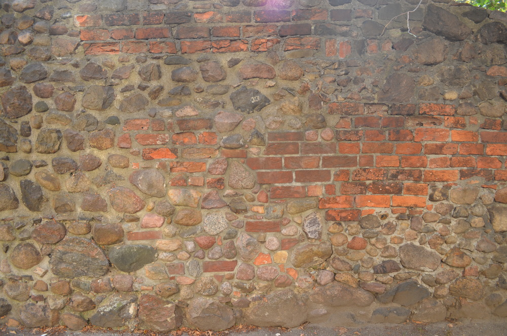 The wall is composed of a patchwork of materials - large stones, filling, different sized bricks. I like how the texture of the wall shifts as you move along it.