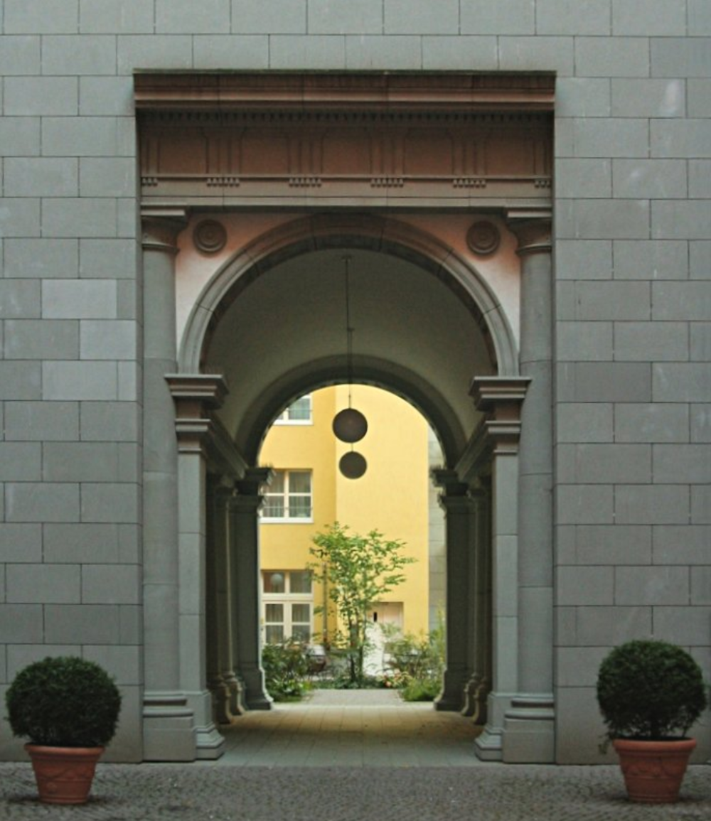 Two of the inner courtyards in the Quartier Schützenstraße building complex. They remind me of an old Italian building, except they were actually built in the 1990s in Berlin. Photo credit:  Creative Commons.