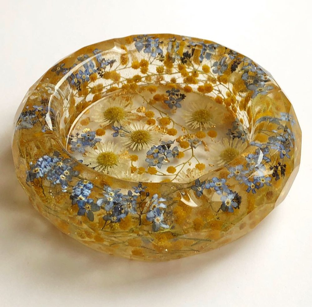Ashtray made with mimosa, forget me nots, asters and gold leaf
