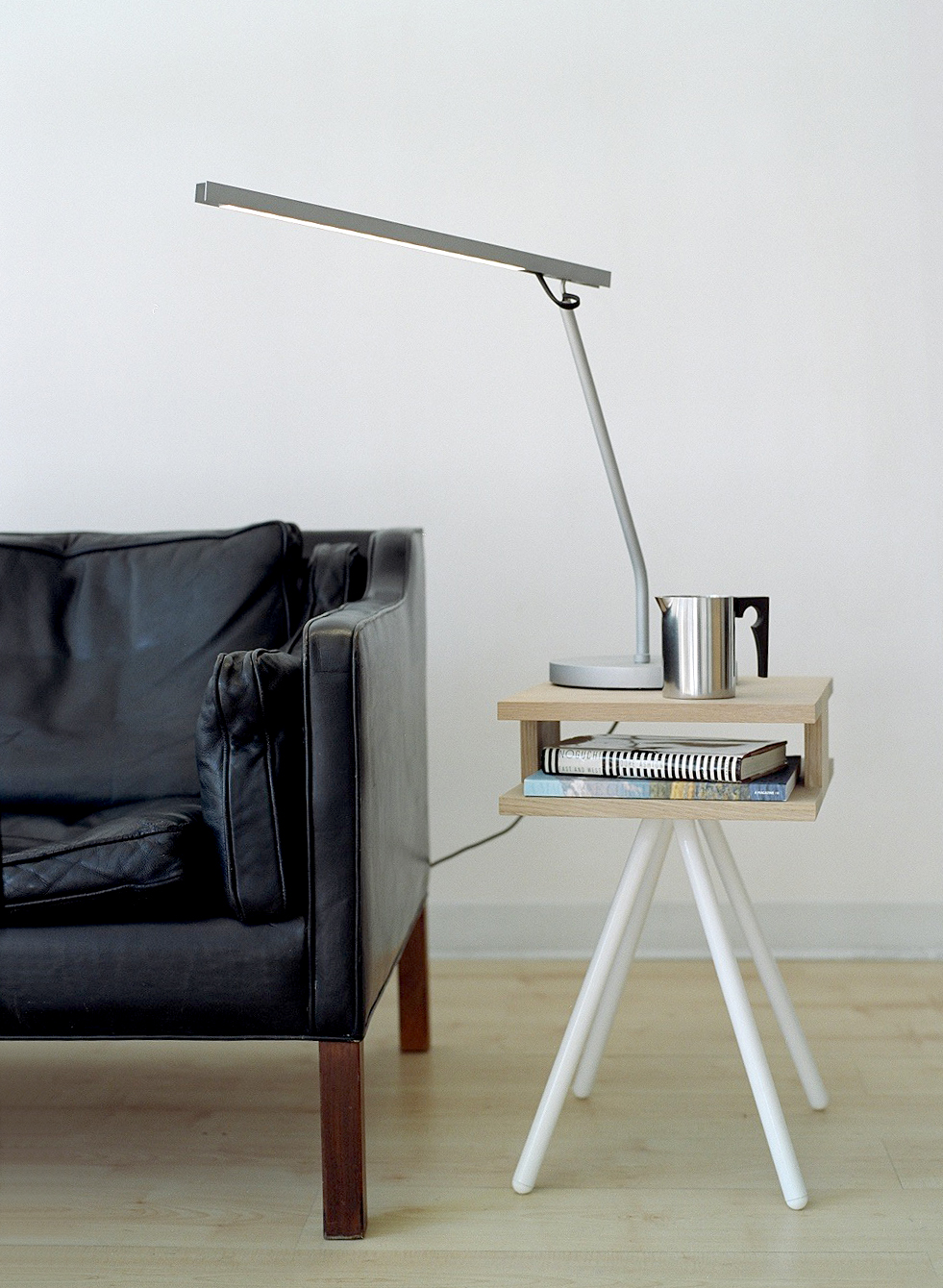 Steel Wood Table with a Maarten Van Severen w111t table lamp, beside a Børge Mogensen 2213 sofa.