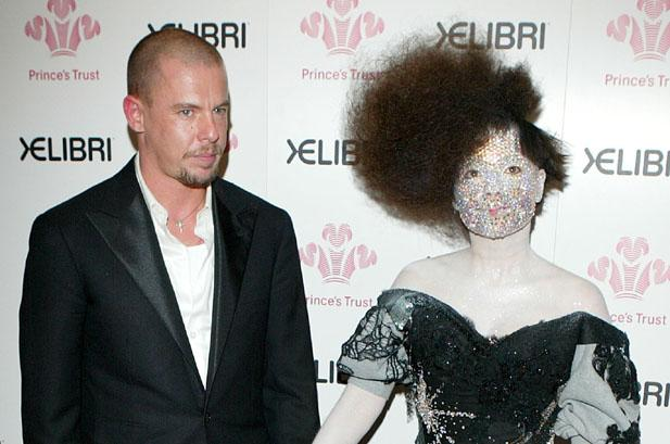 The dearly departed Alexander McQueen, with Bjork in one of his creations.  billboard.com