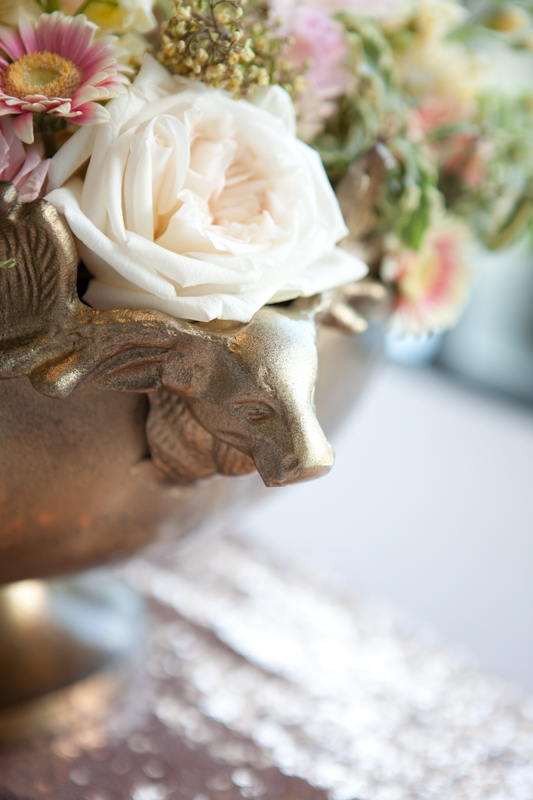detail of rose gold vase and flowers by party mood