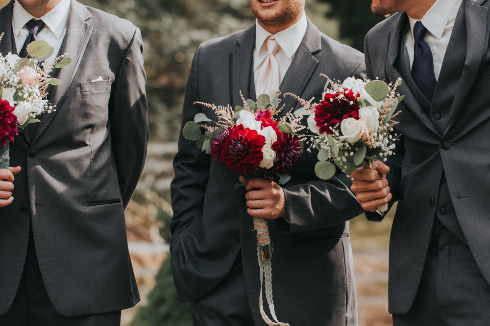 candid detail of groomsmen holding bouquets | Victoria BC Wedding Photographer