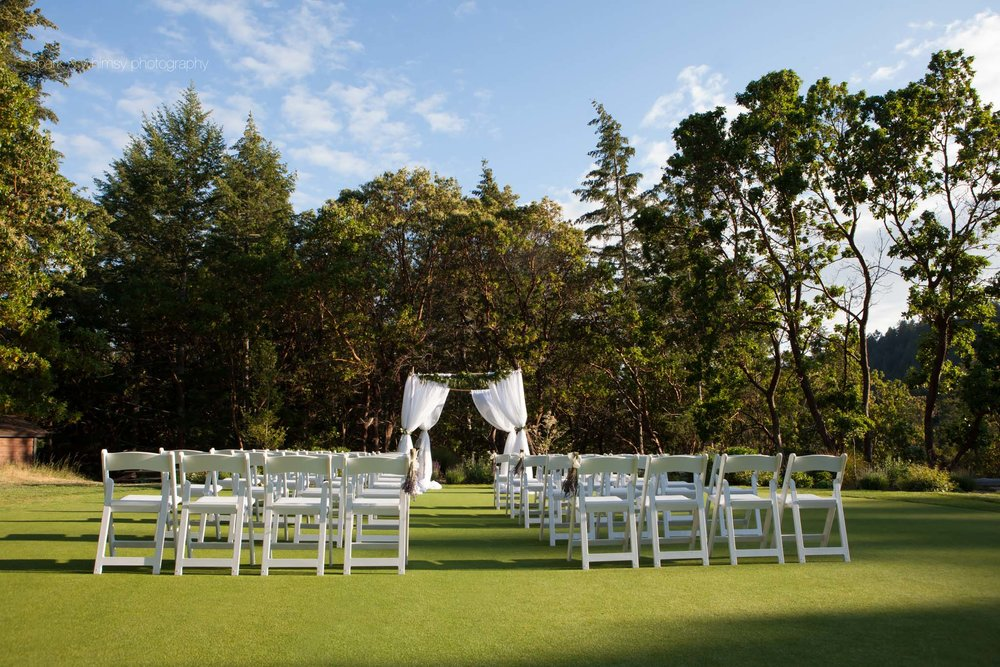 wedding ceremony set up at olympic view golf club | wedding photographer victoria bc