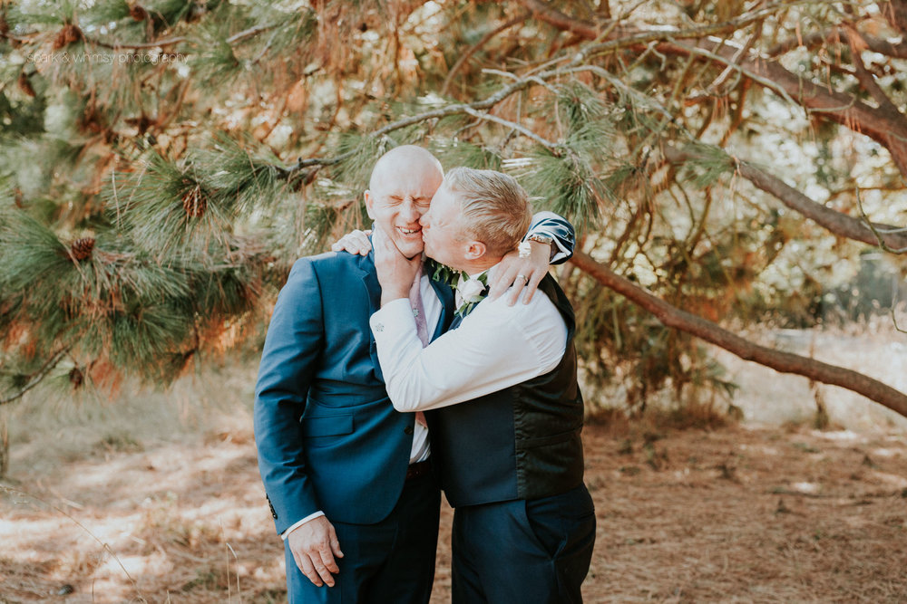 cheeky groomsmen kiss | wedding photographer victoria bc