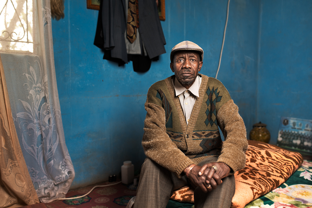 Motlalepula Mokoena , 71 years old from Maseru in Lesotho. He worked on the gold mines for 38 years as a loco driver and a team leader at Freestate Saaiplaas and Free State Geduld mines. He was retrenched in 2002 and paid R36,000 in compensation for his silicosis. He now receives an old age pension and lives alone as his wife has died and his 4 children have left home.