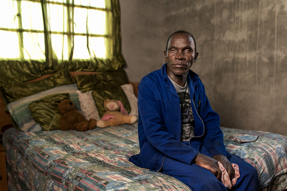 "Malungisa Thole  worked at Western Areas Mine for 19 years and was paid no compensation when he developed silicosis. In his spare time he taught himself to weld and now supports his family with his small welding business.      ""I feel very sad because I worked for the mines, making profit for them but they treated me unfairly by not providing good protective measures."""