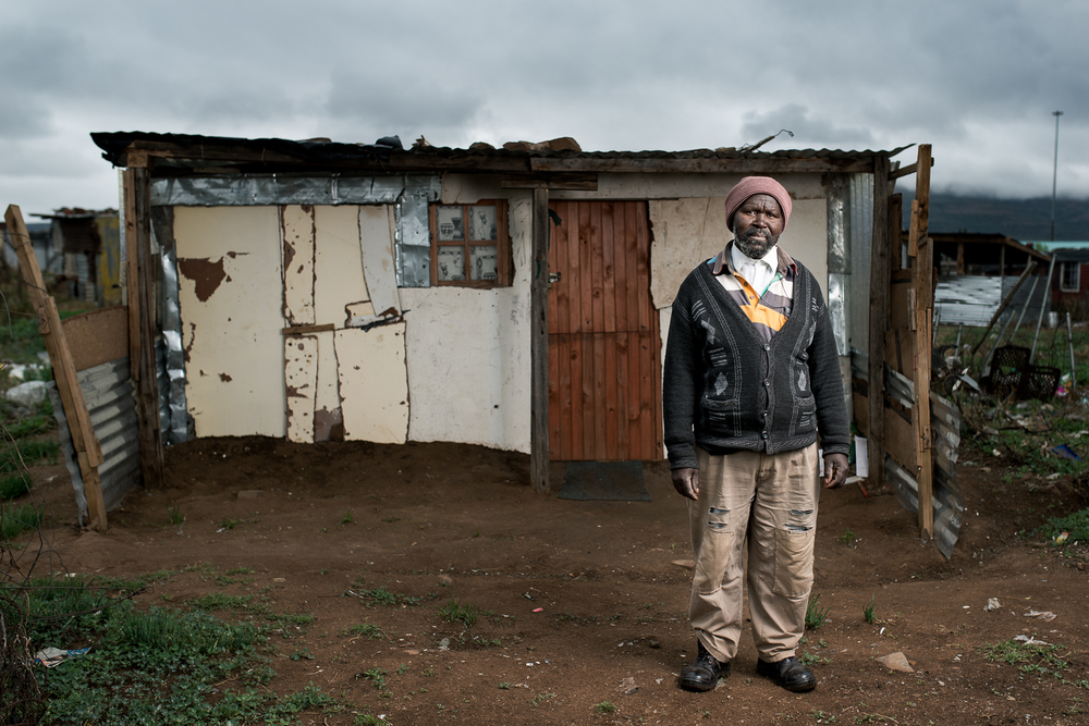 Mthuthuzeli Mtshange  has 8 children. His family live in Flagstaff, 390km from Queenstown. He works as a gardener in Queenstown to make money to send home for his family. He is paid R50 a day (approx. £2.40 or $3.70). He lives in a township on the outskirts of Queenstown as it is all he can afford. Mr Mtshange worked on the gold mines for 35 years and was retrenched without reason in 1996. He was diagnosed with silicosis and tuberculosis and received no compensation from the mines.